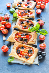 Mini pizza pastry,selective focus on front slice